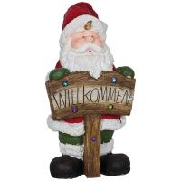 Weihnachtsmann mit WILLKOMMEN-Schild, singend